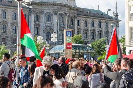 pleas: MUNICH, GERMANY - AUGUST 16, 2014: Pro-Palestinian activists at the demonstrations asking the Israeli government to stop the war in Gaza and to withdraw the armed forces from occupied territories.