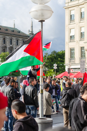 outcry: MUNICH, GERMANY - AUGUST 16, 2014: Palestinian flags, slogans and posters. Demonstration for peace, freedom and independence, and ending the war in Gaza. Editorial