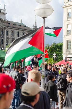 MUNICH, GERMANY - AUGUST 16, 2014: The demonstration in the center of a large European city. Protesters are demanding a peaceful solution to the Arab-Israeli conflict, the cease-fire in Gaza and the liberation of occupied Palestinian territories.