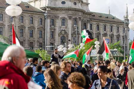 outcry: MUNICH, GERMANY - AUGUST 16, 2014: A rally against the war in Gaza. Protesters demand to stop the shelling of Gaza and Israel withdraw from the occupied Palestinian territories.