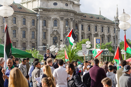 MUNICH, GERMANY - AUGUST 16, 2014: Anti-war rally in support of the Palestinian people. Protesters are asked to stop firing of Gaza Strip and the withdrawal of Israeli troops from the occupied territories.