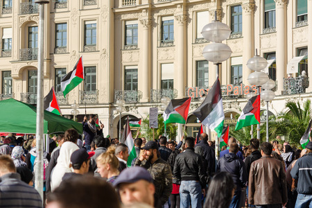 MUNICH, GERMANY - AUGUST 16, 2014: Palestinian activists hold a rally in the center of a major European city against the war in Gaza. Protesters demand that the Israeli government freedom and independence.