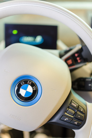 i3: MUNICH, GERMANY - AUGUST 8, 2014: White design interior of environmentally friendly full-time electric car BMW i3. Vertical close-up photo with small DOF.