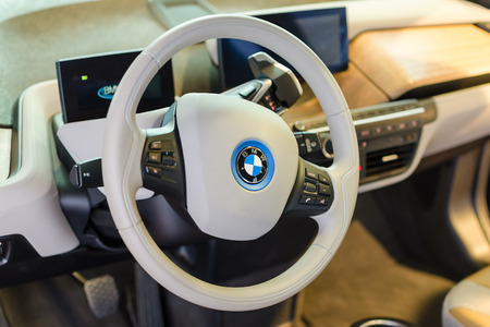 i3: MUNICH, GERMANY - AUGUST 8, 2014: White design interior of environmentally friendly full-time electric car BMW i3.