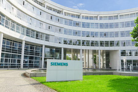ag: Munich, Germany - September 04, 2014: New headquarters office building of Hi-Tech company Siemens AG. This is a biggest scientific research and production center.