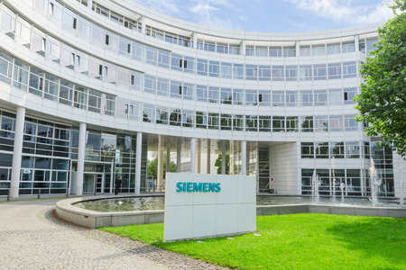 ag: Munich, Germany - September 04: New Siemens AG scientific research and production complex in modern headquarters office building in Munich.