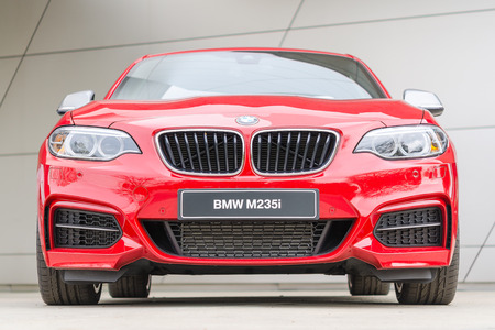 Munich, Germany - October 25, 2014: BMW M235i coupe the first M Performance series European small and inexpensive turbocharged mainstream passenger sports car front view