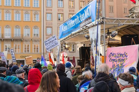 anti nato: Munich, Germany - February 07, 2015: Antiwar peaceful demonstration or protest action against the policy of NATO in Central and East Europe