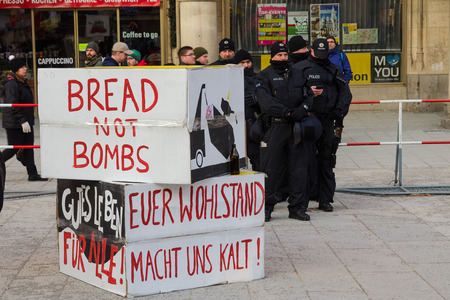 north atlantic treaty organization: Munich, Germany - February 07, 2015: Police cordon and signs banners on protest rally anti-NATO peaceful demonstration in the center of Europe