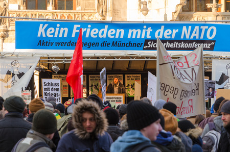 north atlantic treaty organization: Munich, Germany - February 07, 2015: European anti-NATO protest meeting. Text on the banner reads as No friendship with NATO.