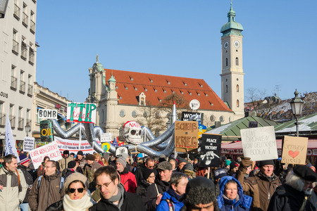 anti nato: Munich, Germany - February 7, 2015: Peaceful demonstration and protest rally against presence NATO and USA military forces in Europe and eastward expansion. Editorial