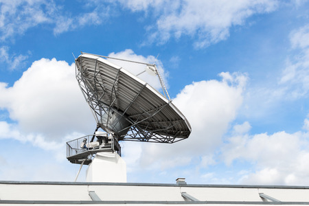 Large satellite communication parabolic dish radar antenna station or astronomical observatory space radio signal telescope against sky Stock Photo