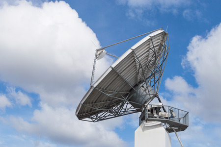 bidirectional: Big radar parabolic radio antenna global telecommunication technology equipment for information data streaming broadcast Stock Photo