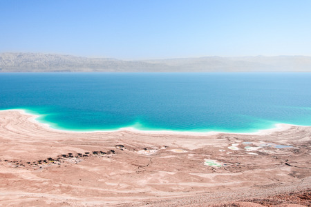 Aerial view Dead Sea coast in desert landscape with therapeutic curative mud and mineral salt