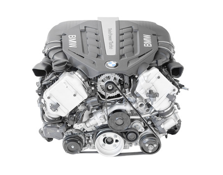 flagship: Munich, Germany - September 28, 2014: New modern flagship top model of irresistibly dynamic and incredibly efficient car engine. BMW TwinPower turbo V8-cylinder top-of-the-range petrol engine isolated on white.