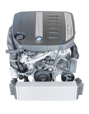 litre: Munich, Germany - September 28, 2014: New modern powerful flagship model of efficient and dynamic car engine. BMW TwinPower turbo 3.0 litre 6-cylinder top-of-the-range diesel powerplant isolated on white.