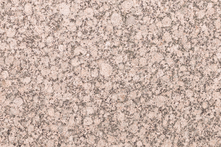 unpolished: Mineral background with red or pink granite texture cut and unpolished surface of decorative trim stone Stock Photo