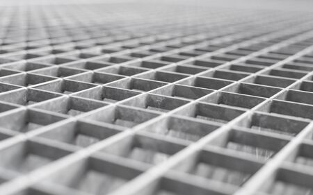 voluminous: Angle metal lattice background with shallow DOF and selective focus point on small cells of grid
