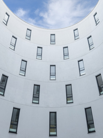 singular architecture: Modern office building design concrete wall and windows vertical perspective stock photo