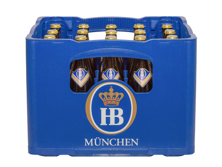 Munich, Germany - June 10, 2016: Isolated on white crate with bottles of classic German traditional Bavarian beer HB Munich