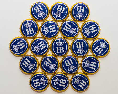 Munich, Germany - June 10, 2016: Many bottle caps of beer from Bavarian brewery Hofbrau Munich