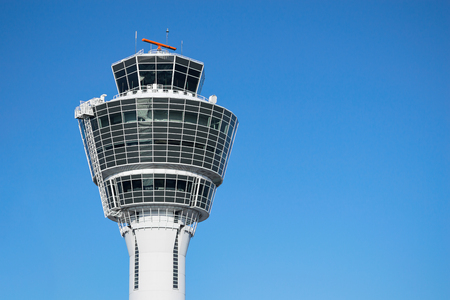 atc: Munich air traffic control tower in airport with clear blue sky and free copy-space place for your text Stock Photo