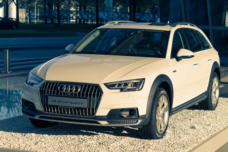 engine powered: Munich, Germany - May 6, 2016: A4 allroad quattro new car model of Audi 4WD SUV crossover. Outdoor stock photo with split toning effect was captured in a public place with free access.