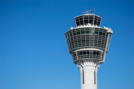Modern air traffic control tower in international passenger airport over clear blue sky Stock Photo
