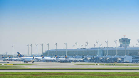 stoppage: Munich, Germany - May 6, 2016: The new modern Lufthansa satellite terminal at Munich airport, in operation since April 2016, is first midfield international passenger terminal in Germany. Editorial