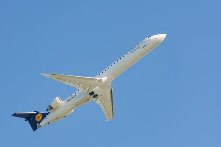 Munich, Germany - May 6, 2016: Aircraft Bombardier Canadair Regional Jet 900 CRJ-900 of Lufthansa Regional CityLine airlines taking off from Munich international airport and gains altitude