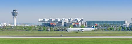 Munich, Germany - May 6, 2016: Passenger airliner Airbus A340 of South African Airways taxiing from Munich airport terminal to runway. Panoramic editorial stock photo.