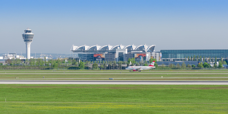 Munich, Germany - May 6, 2016: Panoramic view of Munich international airport is named in memory of Franz Josef Strauss with passenger jet plane of Austrian Airlines.
