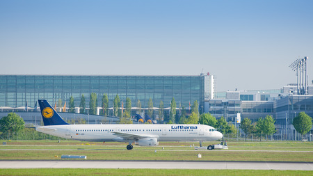 Munich, Germany - May 6, 2016: Jet airliner Airbus A321-231 of Deutsche Lufthansa AG airlines after landing taxiing on pushback tug at Munich international passenger airport