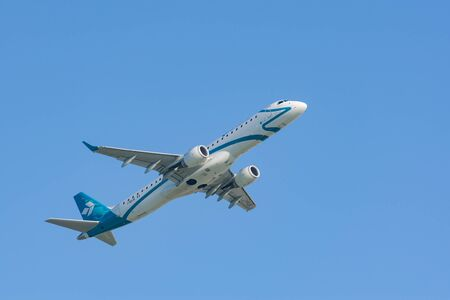 turbojet: Munich, Germany - May 6, 2016: Jet plane Embraer E-Jet ERJ-195 of Air Dolomiti Italian airlines take off from Munich international passenger airport and gains altitude.