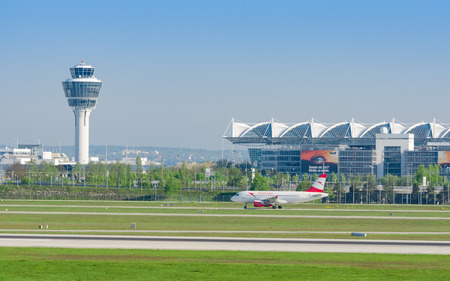 Munich, Germany - May 6, 2016: Munich international airport panoramic view with passenger airplane of Austrian Airlines taxiing to runway Editorial