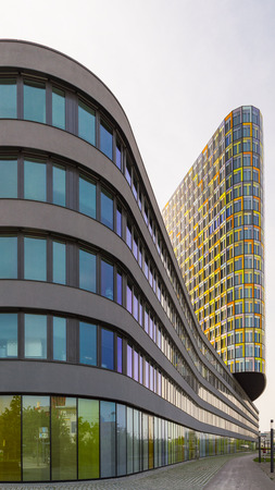 guise: Munich, Germany - May 12, 2015: Exterior of unusual office building with smooth flowing. Headquarters of German automobile club ADAC.