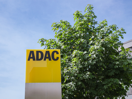 Munich, Germany - May 12, 2015: ADAC signage with German automobile club logo largest automobile association in Europe. Editorial