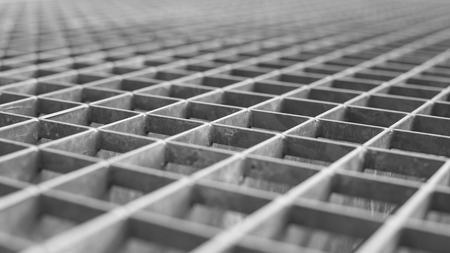 metal mesh: Metal lattice with small cells grid. Stock photo background with shallow DOF and selective focus point.