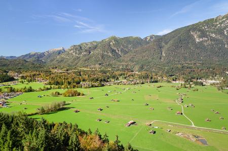 Alpine aerial view of Bavarian valley with fresh green pastureland in Garmisch-Partenkirchen region