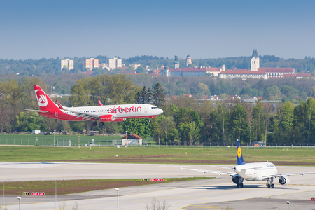 Munich, Germany - May 6, 2016: Airplane Boeing 737 of Air Berlin airline landing in Munich international airport. Editorial