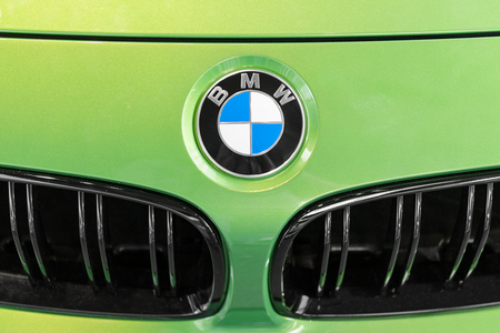 Munich, Germany - July 15, 2017: Close up BMW logo on hood of green lime presentable luxury car Editorial