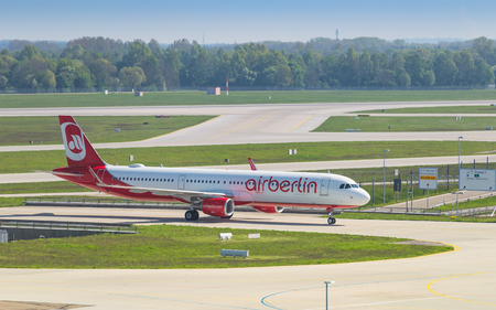 Munich, Germany - May 6, 2016: Airliner Airbus A321 of Air Berlin low-cost airline taxiing from runway to terminal after landing in Munich international airport Editorial