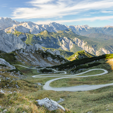 Bavarian autumn Alpine landscape with winding mountain pathway for hiking