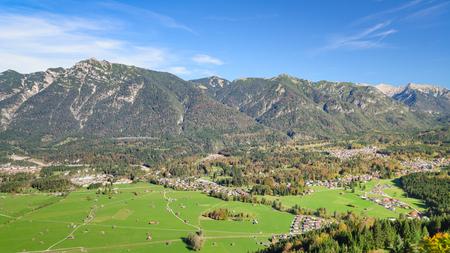 Aerial landscape with fresh green grazing meadow in Bavarian Alpine valley Standard-Bild