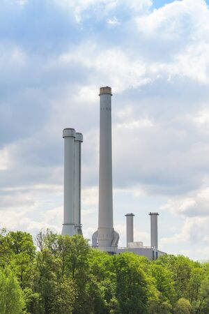 Main cause of environmental pollution to atmosphere is industrial emissions from plant chimney Standard-Bild