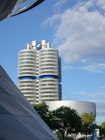 Munich, Germany - July 15, 2017: New four-cylinder tower of modern BMW Headquarters building with exhibition center and museum Editorial