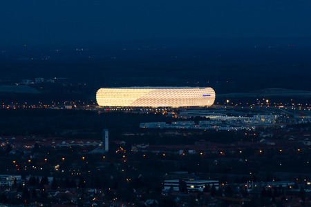 Munich, Germany - December 14, 2016: Night aerial view of exterior football stadium Allianz Arena the second-largest arena in Germany