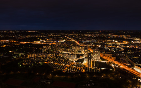 Aerial panoramic cityscape view with bright lights in night Munich Standard-Bild
