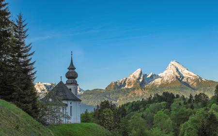 Morning panoramic landscape with Maria Gern chapel and snow-capped peaks of Watzmann mountain in Bavarian national park Berchtesgaden
