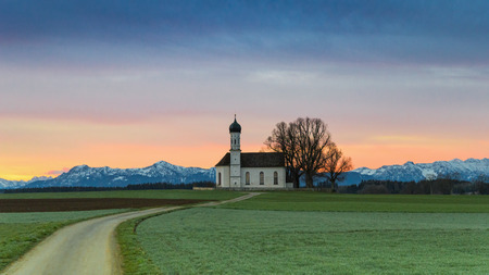 Morning Alpine landscape with sunrise over St. Andreas chapel in Etting in district Weilheim-Schongau